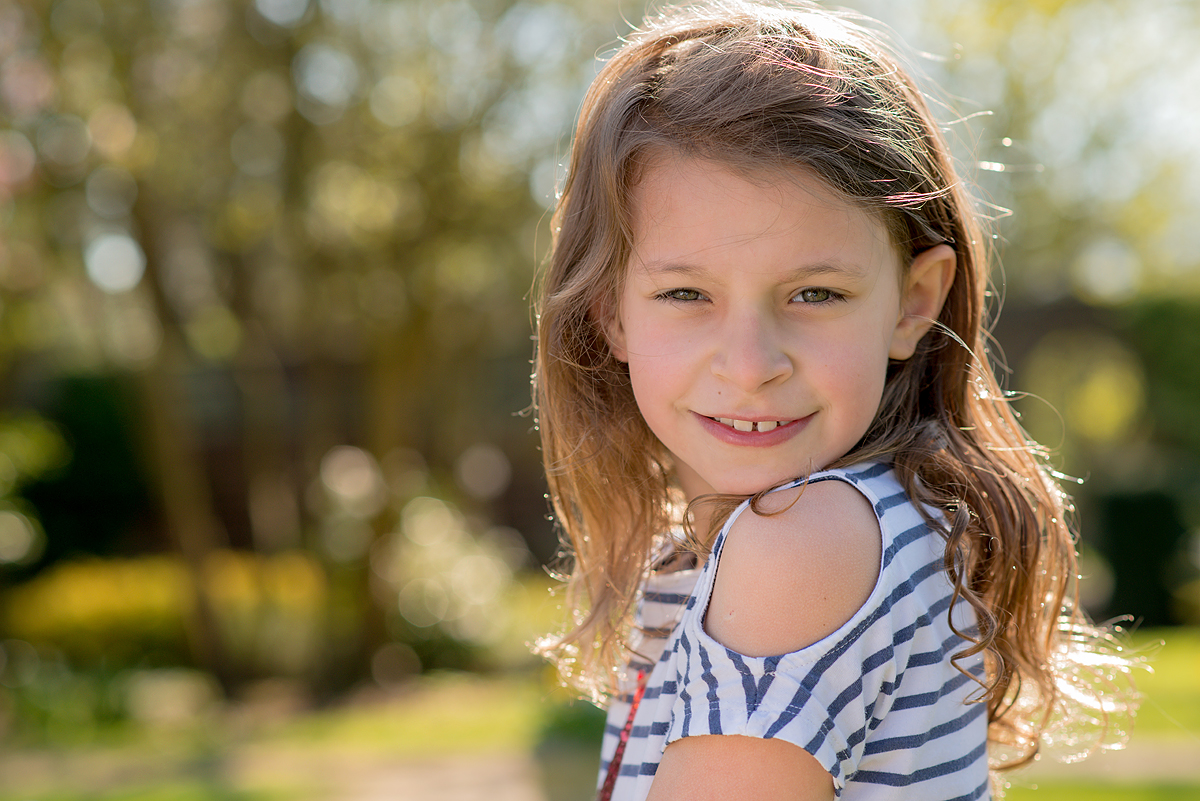 Portrait of a girl in a blue and white striped top in Sunbury Walled Gardens